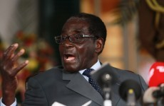 Opposition cries foul as Mugabe claims landslide election victory
