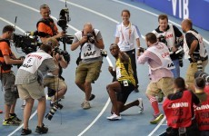 Usain Bolt powers to third world 200m title