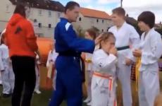 Taekwon-Do instructor kicks board into little girl's face