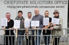 Security staff at state solicitor's office protest after being replaced
