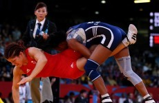 Wrestling wins reprieve for 2020 Olympics