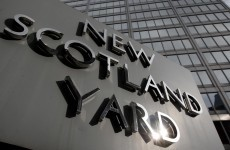 Police arrest two News of the World journalists over phone hacking