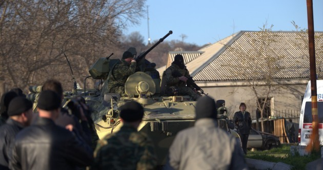 Russian forces storm Ukraine airbase. Reports of soldier shot.