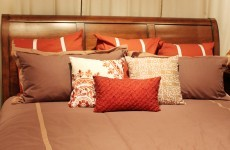 The Burning Question*: Are extra cushions on the bed pretty – or pointless?