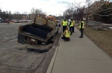 Unfortunate pothole-filling crew manage to get stuck in giant pothole