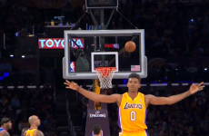 A perfect picture of Nick Young celebrating a three-point shot that didn't go in