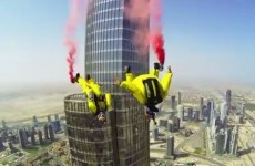 Watch two daredevils BASE jump off the tallest building in the world