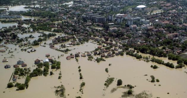 """This is Armageddon"": Thousands flee Balkans floods in Bosnia's worst exodus since war"