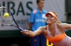Sharapova sees off Bouchard in three sets to book final berth against Halep