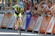 Rogers finally wins a Tour de France stage, takes a bow as he crosses the line