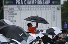 Rain threatens to delay McIlroy's back-to-back major quest until Monday