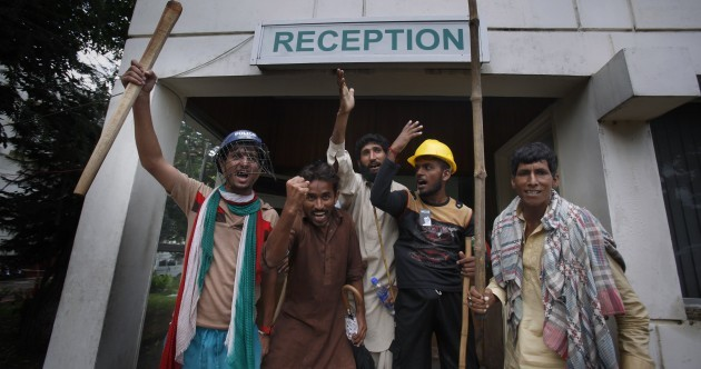 Pakistan state TV back on air after protesters storm building