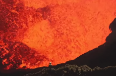 Dramatic video shows two men diving into an exploding volcano