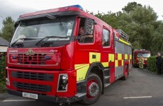 Woman in critical condition after escape from house fire