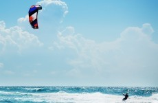 Kite surfer forced to swim long distance back to shore after equipment failure
