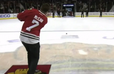 Richie McCaw pulls on a Blackhawks jersey and tries his hand at ice hockey