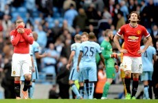 Aguero gives City spoils against 10-man United