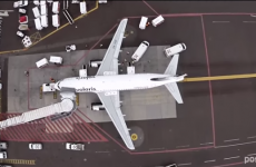 Drone footage shows what it's like to be a bird flying over an airport