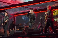 Chris Martin and Bruce Springsteen stood in for Bono and performed with U2 last night