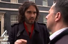 "Russell Brand calls reporter ""a snide"" after he is asked how much his home is worth"