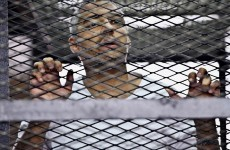 Egypt's highest court orders retrial of three Al-Jazeera journalists