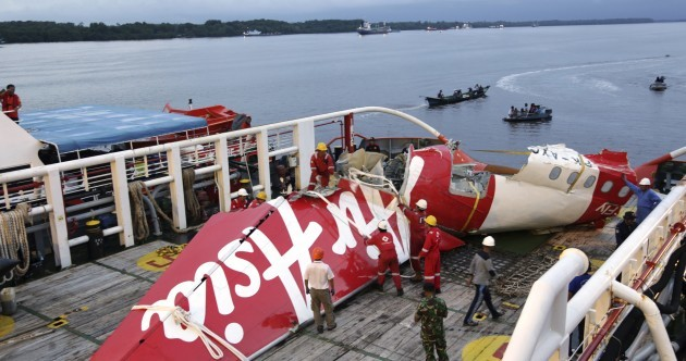 Bodies found belted to seats near AirAsia crash site