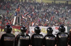 Egyptian police and football fans clash leaving dozens dead