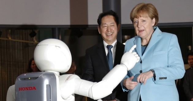 Angela Merkel had an uncomfortable encounter with a dancing robot today