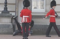 A Buckingham Palace guard fell in front of tourists, but remained cool as a cucumber