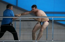 A fan broke through security to have a go at the world diving series & no it wasn't Ashley Young
