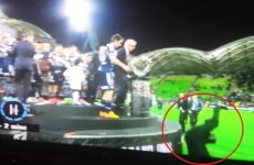 One of Australia's richest men fell head-first off the podium during a trophy presentation