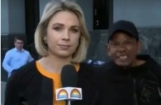 This reporter stayed totally cool as a man was arrested behind her on live TV