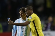 Elimination didn't stop a Jamaican player from taking a selfie with Lionel Messi last night