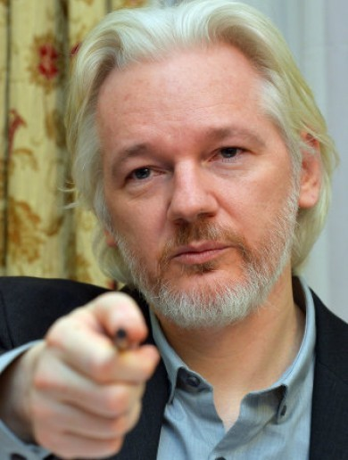It's Julian Assange's birthday and he's spending it arguing with the Republic of France