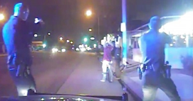 WATCH: Unarmed man shot dead by police after taking his hat off