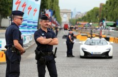 Paris police fire on car driven through Tour de France barrier