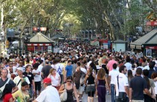 Manhunt in Barcelona as two injured in gun attack on main tourist street