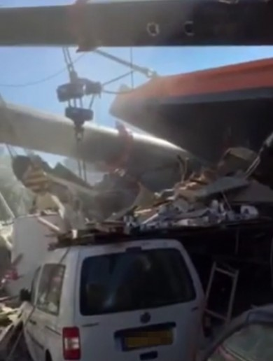 WATCH: At least 20 people injured after cranes collapse on to houses
