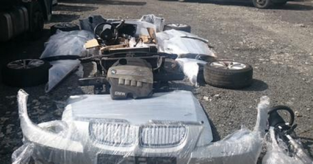 Two stolen luxury cars found chopped up in a trailer bound for Lithuania