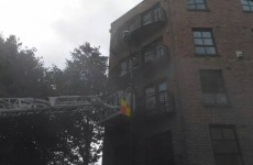 Pics: Woman rescued from Dublin apartment balcony after fire started in bedroom