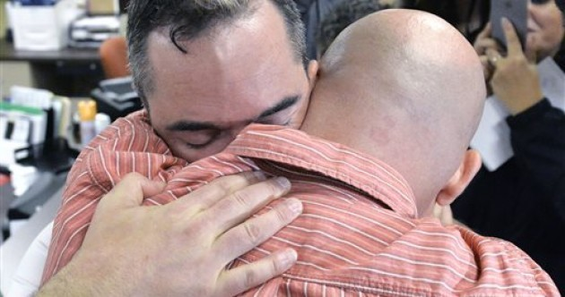 Joyous scenes – and insults – as gay couples get marriage licences