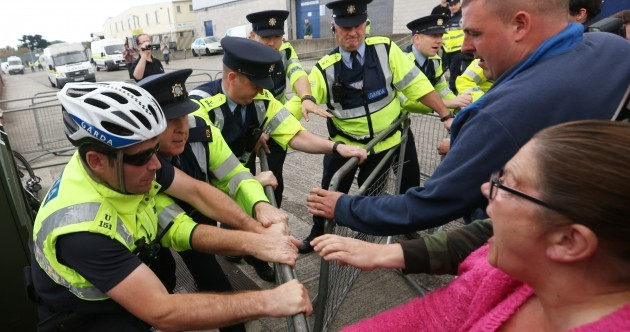 Pictures: Water protesters clash with gardaí at Joan Burton food bank event