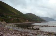 A Kerry coastal community is cut off following a cliff landslide