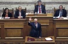 Greek prime minister survives confidence vote
