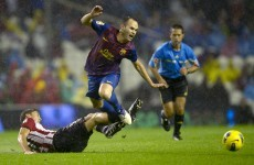 Vamos: Barca slip in the rain while it's seven up for Real