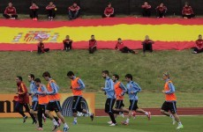 Champions Spain undergo light first training run
