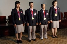 North Korea Olympics squad return to heroes' welcome