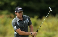 Golf: McIlroy leads, Oosthuizen and Woods chasing