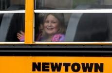 Four days after massacre, children return to school in Newtown