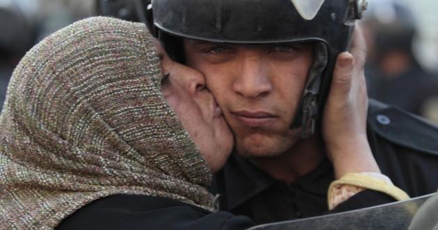 Egypt's under-pressure president sacks cabinet and pledges reform